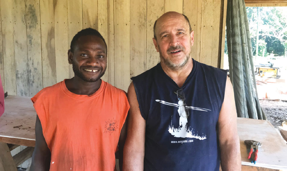 Cleon Watts, right, made new friends when he went from Community Baptist Church to Papua New Guinea to help build a house for Seth and Kaitlyn Sanford