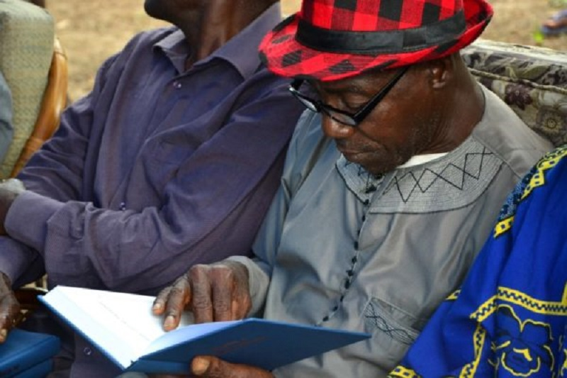 West African man reading his new Bible